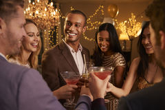 Group Of Friends With Drinks Enjoying Cocktail Party stock photography