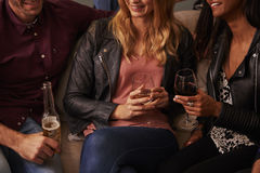Group Of Friends With Drinks Enjoying House Party Together Stock Photography