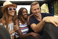 Group Of Friends Driving Open Top Car On Country Road Royalty Free Stock Photo
