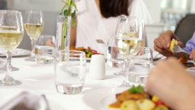 Group of friends eating dinner together Royalty Free Stock Image