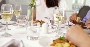 Group of friends eating dinner together Stock Images