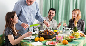 Group of friends eating at festive table Royalty Free Stock Images