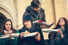 Group Of Friends Eating Pizza Outdoors Royalty Free Stock Photo