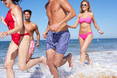 Group Of Friends Enjoying Beach Holiday Stock Photo