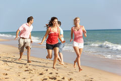 Group Of Friends Enjoying Beach Holiday In The Sun Stock Images