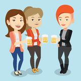Group of friends enjoying beer at pub. Royalty Free Stock Photo