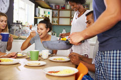 Group Of Friends Enjoying Breakfast In Kitchen Together Stock Images