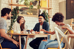 Group of friends enjoying in cafe Royalty Free Stock Photography