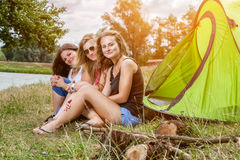 Group of friends enjoying a camping holiday Stock Image