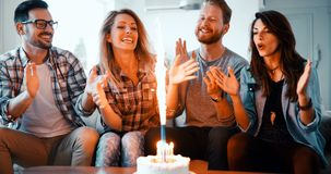 Group of friends enjoying and celebrating birthday and partying stock photo