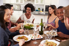 Group Of Friends Enjoying Dinner Party At Home Stock Photos