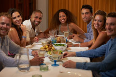Group Of Friends Enjoying Dinner Party At Home Together royalty free stock photos