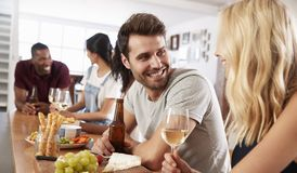 Group Of Friends Enjoying Dinner Party At Home Together Royalty Free Stock Image