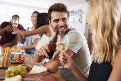 Group Of Friends Enjoying Dinner Party At Home Together Stock Photo