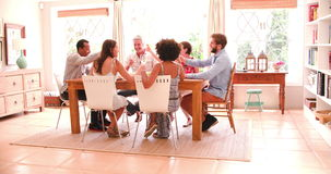 Group Of Friends Enjoying Dinner Party At Home Together. Group of friends at home sitting around table enjoying dinner party together. Shot in 4k on Sony FS700 stock video footage