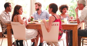 Group Of Friends Enjoying Dinner Party At Home Together stock video footage
