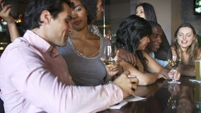 Group Of Friends Enjoying Drink At Bar Together stock video footage