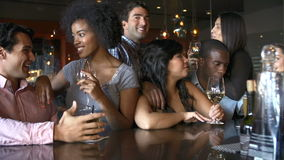 Group Of Friends Enjoying Drink At Bar Together stock video
