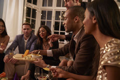 Group Of Friends Enjoying Drinks And Snacks At Party Royalty Free Stock Images