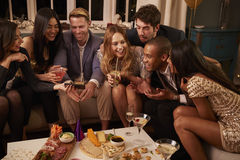 Group Of Friends Enjoying Drinks And Snacks At Party Stock Images