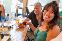 Group of Friends Enjoying Glasses of Micro Brew Beer At Bar.  stock image