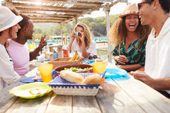 Group Of Friends Enjoying Lunch And Taking Photographs Stock Images