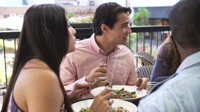 Group Of Friends Enjoying Meal At Outdoor Restaurant stock footage