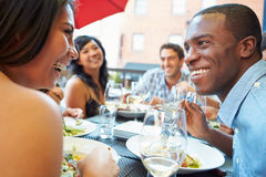 Group Of Friends Enjoying Meal At Outdoor Restaurant Stock Images