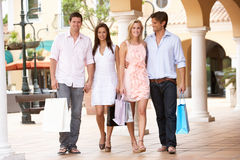 Group Of Friends Enjoying Shopping Trip Royalty Free Stock Images