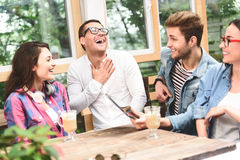 Group of friends enjoying talking together royalty free stock image