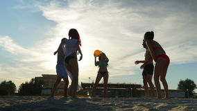 Group of friends enjoying their time on the beach and playing volleyball stock video footage