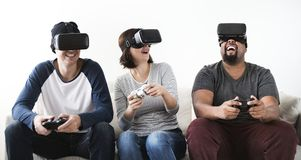 Group of friends enjoying virtual reality game Stock Photography