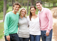 Group of friends enjoying walk in park Royalty Free Stock Images
