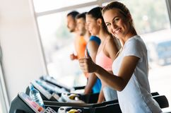 Group of friends exercising on treadmill machine. In gym Royalty Free Stock Photos