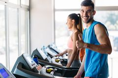 Group of friends exercising on treadmill machine. In gym Royalty Free Stock Image