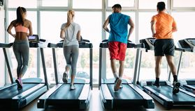 Group of friends exercising on treadmill machine stock images