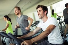 Group of friends exercising on treadmill machine royalty free stock photography