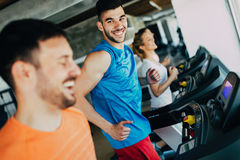 Group of friends exercising on treadmill machine Stock Photos