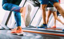 Group of friends exercising on treadmill machine. In gym Royalty Free Stock Photo