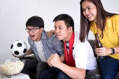Group of friends fanclub watching soccer match on tv and cheerin. G football team, celebrating with beer and popcorn at home, sports and entertainment concept Stock Images
