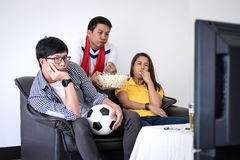 Group of friends fanclub watching soccer match on tv and cheerin. G football team, celebrating with beer and popcorn at home, sports and entertainment concept Stock Image
