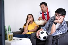 Group of friends fanclub watching soccer match on tv and cheerin. G football team, celebrating with beer and popcorn at home, sports and entertainment concept Stock Photography