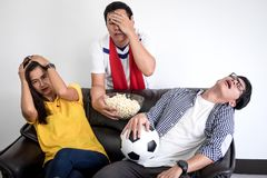 Group of friends fanclub watching soccer match on tv and cheerin. G football team, celebrating with beer and popcorn at home, sports and entertainment concept Royalty Free Stock Images