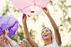 Group of friends floating chinese lanterns Stock Photo