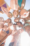 Group of friends forming a huddle Stock Image