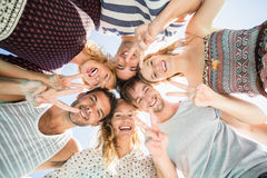 Group of friends forming a huddle Stock Photo