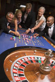 Group of friends of gambling in casino Royalty Free Stock Images