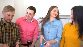 Group of friends gather for dinner in a kitchen. 4 k stock video footage