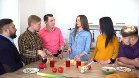 Group of friends gather for dinner in a kitchen. Group of friends gather for dinner in a kitchen, 4 k stock video footage