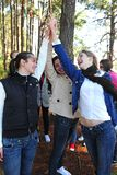 Group of friends giving a high-five. Group of teenage girls on vacation during a trip in the forest royalty free stock images